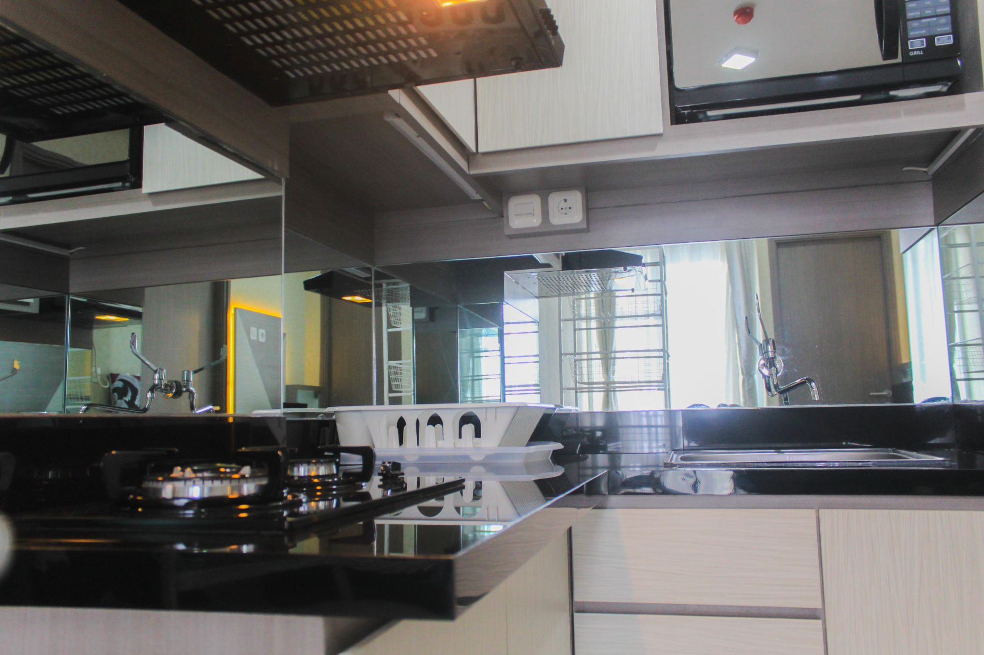 Cozy and Homey 2BR at Emerald Bintaro Apartment By Travelio, Tangerang Selatan