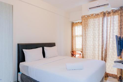 Spacious Studio Akasa Pure Living Apartment BSD By Travelio, South Tangerang