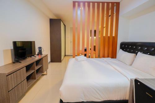 Elegant 1BR at Grand Kamala Lagoon Apartment By Travelio, Bekasi