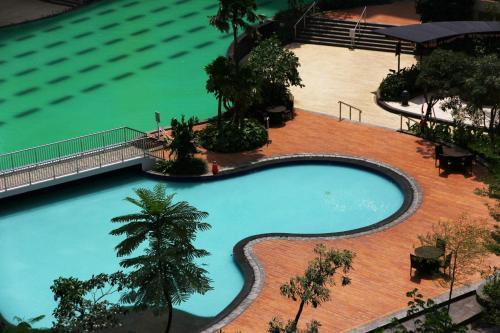 Deluxe and Comfortable 2BR The Springlake Summarecon Apartment By Travelio, Bekasi