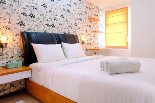 1BR Sea View Condominium at Green Bay Pluit Apartment By Travelio, North Jakarta