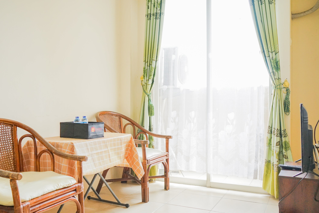 Homey and Simple 2BR at The Medina Apartment By Travelio, Tangerang