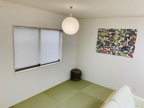 Guesthouse Gosamaru, Yomitan