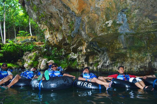 One Day Tour Cave Tubing Goa Pindul - Pantai Timang with lunch  by Jogja Sentosa Tours