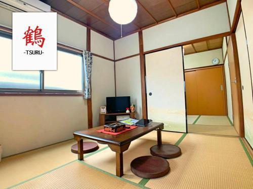 Sano San Chi Tsuru, Izumisano