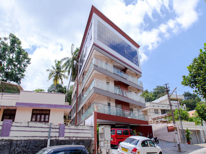 OYO 5805 Uthradam Towers, Thiruvananthapuram