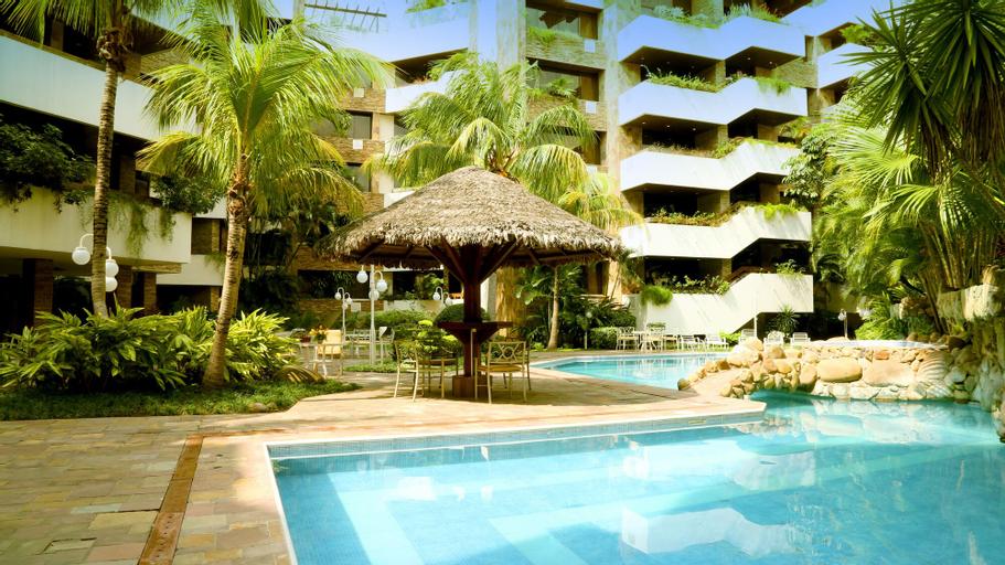 Yotau All Suites Hotel, Andrés Ibáñez