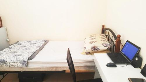 Single room or sharing with One or two professional bachelors,