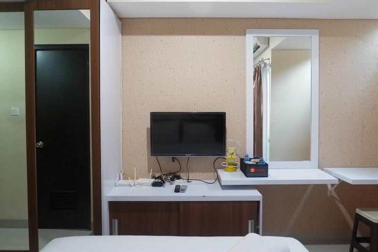 Compact Studio Room at Tamansari Papilio Apartment By Travelio, Surabaya