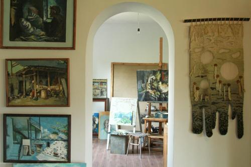 Art gallery house in fruit garden,