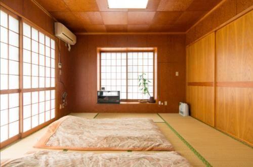 Relaxing Stay at Large Tatami Room (max 6ppl), Yonabaru