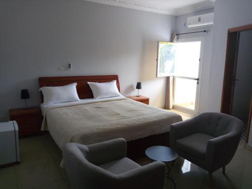 Edenia Hotel, Komo-Mondah