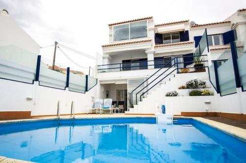 House with 4 bedrooms in Ericeira with wonderful sea view private pool furnished terrace 500 m from , Mafra