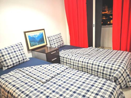 Twin Sharing Furnished Room near the River and Brao de Prata Station, Lisboa