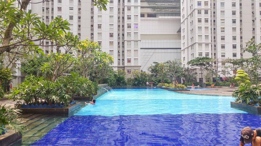 Cozy 2BR Baywalk Green Bay Apartment By Travelio, North Jakarta