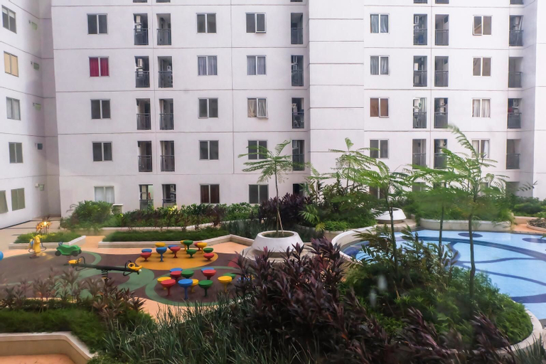 Spacious and Cozy 1BR Bassura City Apartment By Travelio, East Jakarta