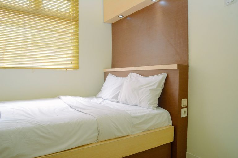 Fully Furnished and Cozy 2BR at Green Pramuka City Apartment By Travelio, Central Jakarta