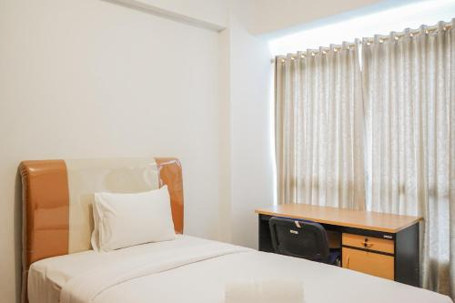 Comfy and Minimalist Studio Apartment Scientia Residence Tower B By Travelio, Tangerang