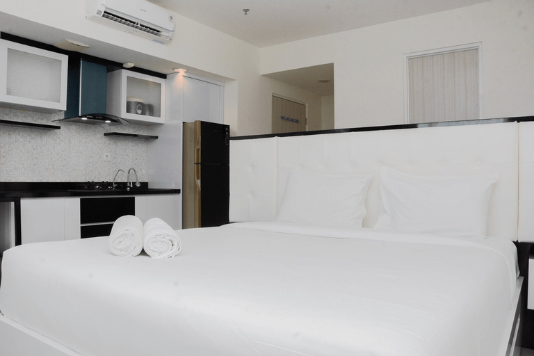 Pleasant and Modern Studio Grand Kamala Lagoon Apartment By Travelio, Bekasi