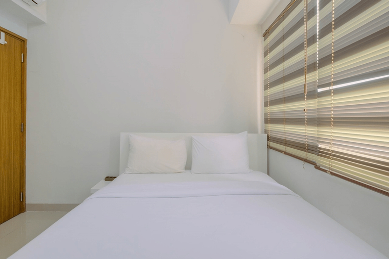 Minimalist and Posh 1BR The Oasis Cikarang Apartment By Travelio, Cikarang