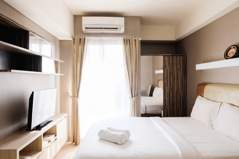 Homey Studio Room at Serpong Greenview Apartment By Travelio, Tangerang Selatan