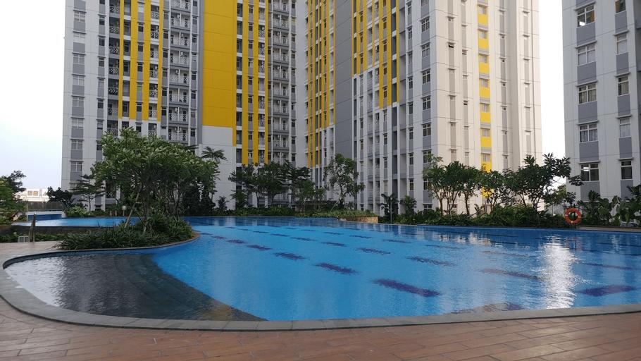 Nice 2BR at Springlake Summarecon Bekasi Apartment By Travelio, Bekasi