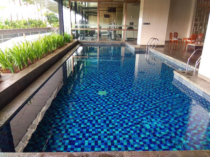 Elegant 1BR Kemang Village Apartment By Travelio, South Jakarta