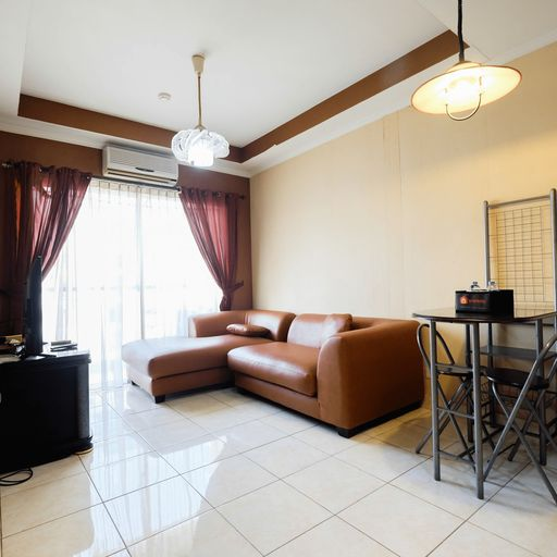Modern 2BR at City Home Apartment with Sofa Bed near MOI By Travelio, Jakarta Utara