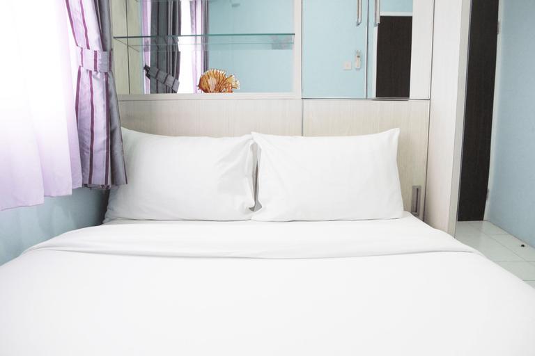 Comfortable 2BR Mutiara Bekasi Apartment By Travelio, Bekasi