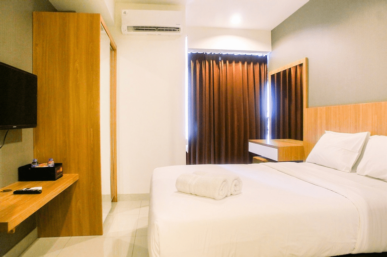 Cozy Studio Grand Kamala Lagoon Apartment By Travelio, Bekasi