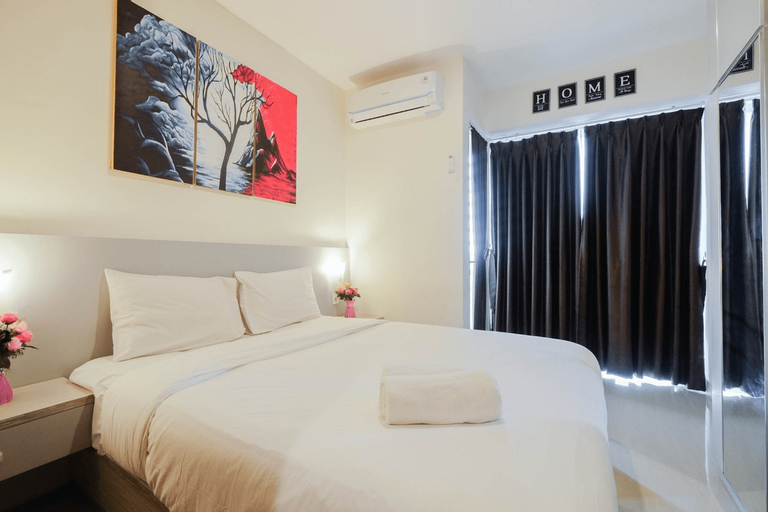 Minimalist and Stylish 1BR Grand Kamala Lagoon Apartment By Travelio, Bekasi