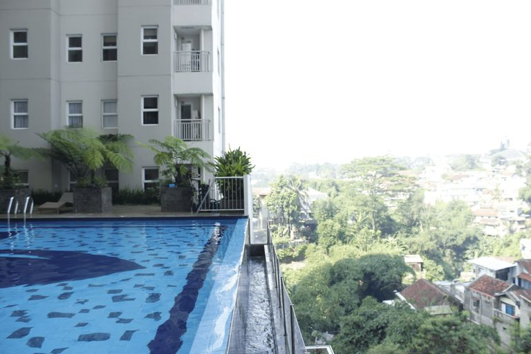Direct Access to Pool 2BR Apartment at Parahyangan Residence By Travelio, Bandung