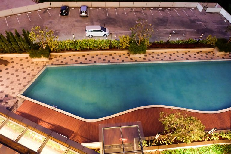 Modern 1BR Oasis Cikarang Apartment By Travelio, Cikarang
