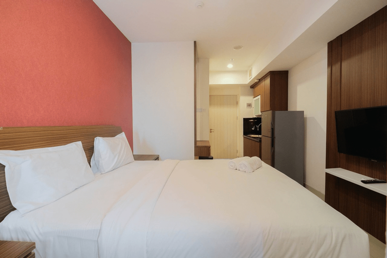 Homey Studio Room at Grand Kamala Lagoon Apartment By Travelio, Bekasi