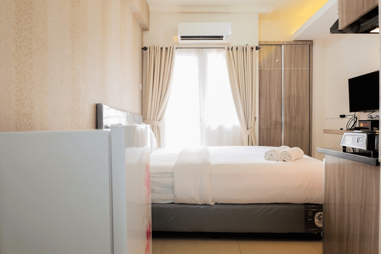 Comfortable Fully Furnished Studio Green Pramuka City Apartment By Travelio, Central Jakarta
