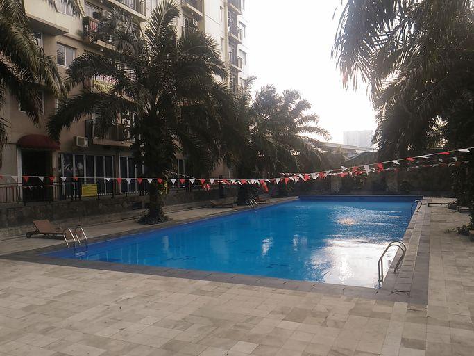 Best Price 2BR Mutiara Bekasi Apartment By Travelio, Bekasi