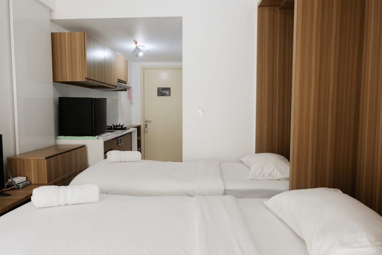Compact Studio Apartment @ M-Town Residence with Pool View By Travelio, Tangerang