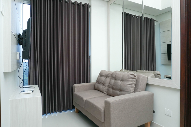 Simple and Minimalist 3BR Apartment at Puri Mansion By Travelio, West Jakarta
