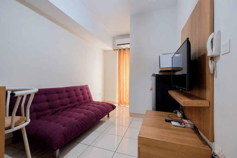Homey and Comfortable 2BR Springlake Summarecon Apartment By Travelio, Bekasi