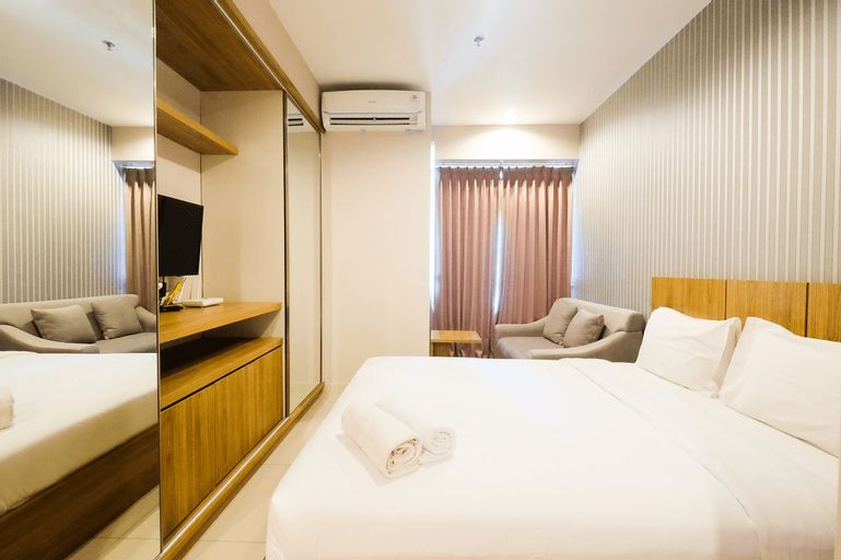 Best Furnished Studio at Grand Kamala Lagoon Apartment By Travelio, Bekasi
