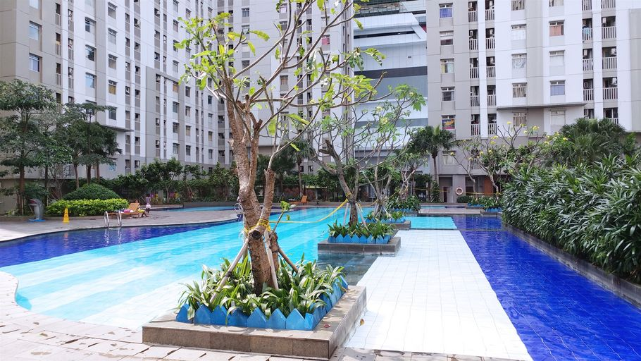 Green Bay Pluit 2BR Apartment With Direct Access To Shopping Center By Travelio, North Jakarta