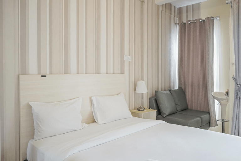 Minimalist and Stylish Studio Skylounge Tamansari Apartment By Travelio, Tangerang