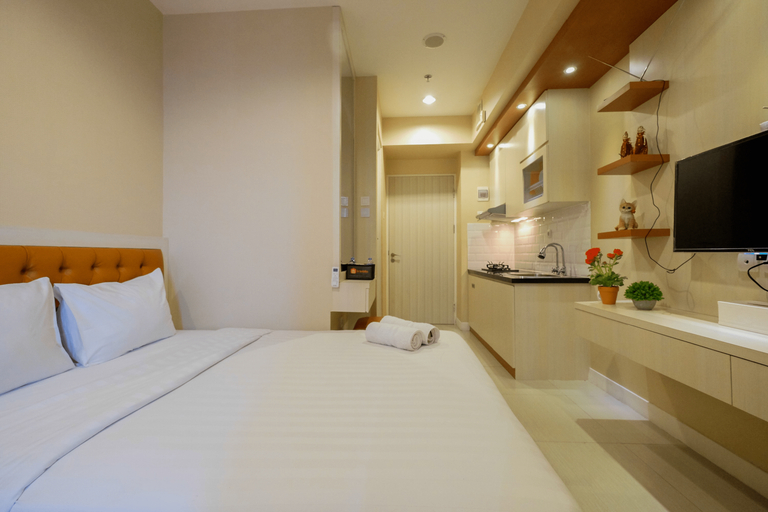 Relaxing Studio Grand Kamala Lagoon Apartment By Travelio, Bekasi