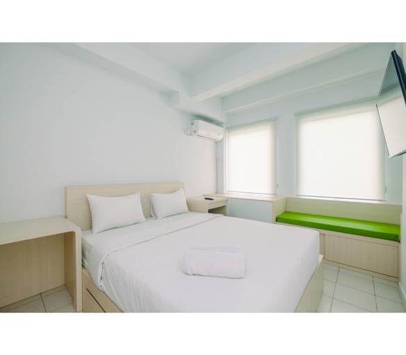 Comfy and Minimalist 1BR Patraland Urbano Apartment near Bekasi Station By Travelio, Bekasi