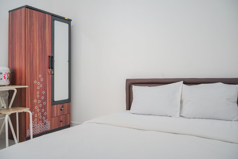 Cozy and Contemporary Studio Apartment at Aeropolis Residence By Travelio, Tangerang