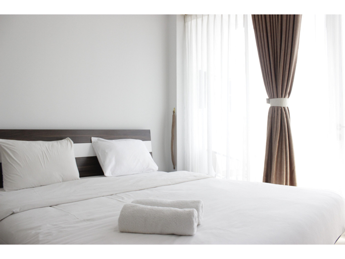 Pleasant 1BR Apartment with Sofa Bed at Dago Suites By Travelio, Bandung