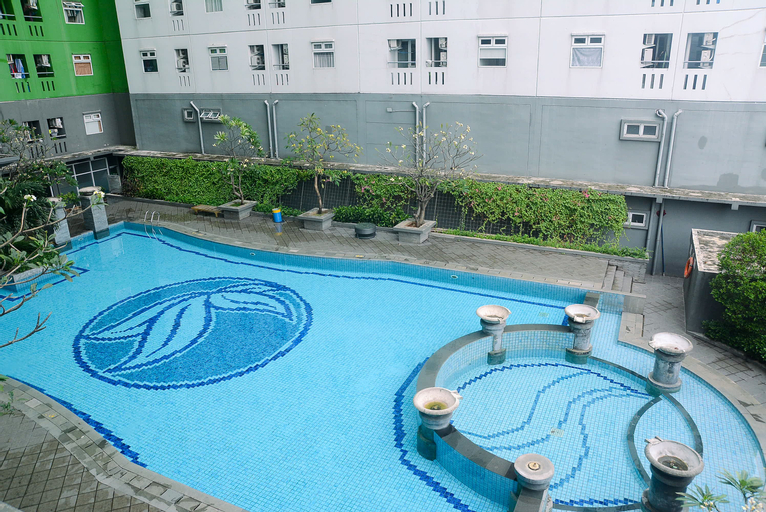 Tidy 2BR with Modern Design Green Pramuka City Apartment By Travelio, Central Jakarta