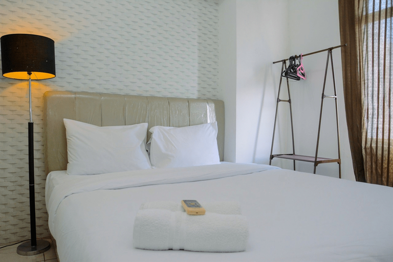 Spacious and Comfortable 2BR Green Bay Pluit Apartment By Travelio, North Jakarta