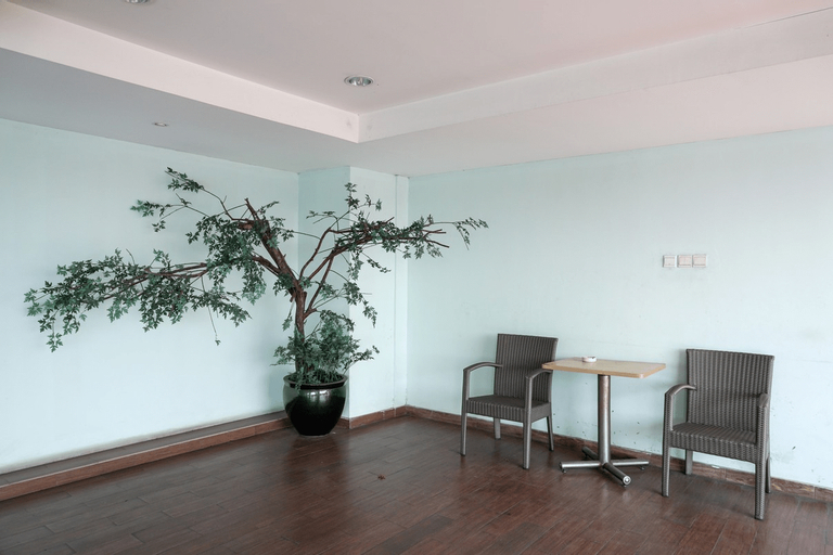 Functional and Compact 1BR Belmont Apartment By Travelio, West Jakarta
