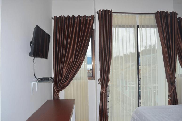 Opriss Hotel, Toba